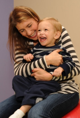 Jack Thomas, who has Fragile X syndrome, in photo with his mother